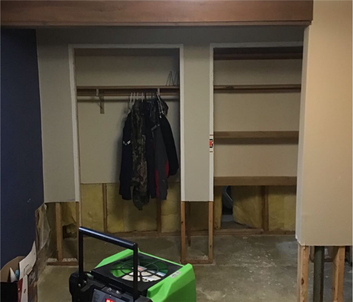 Two closets with no doors and trims, plus, the walls outside and inside closet are cut out at least 1 foot from the bottom.