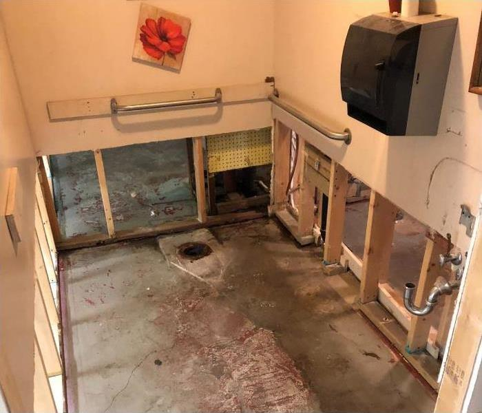 A bathroom that is gutted out.