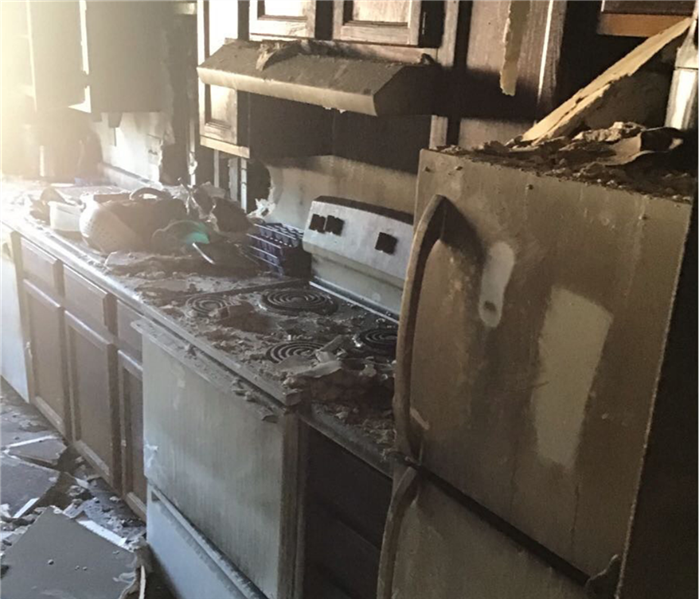 A small kitchen that has been damaged by a fire